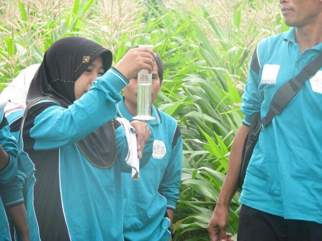 woman measuring rainfall